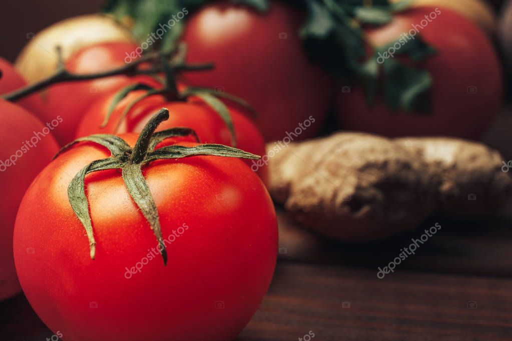 fresh ripe tomatoes on wooden table