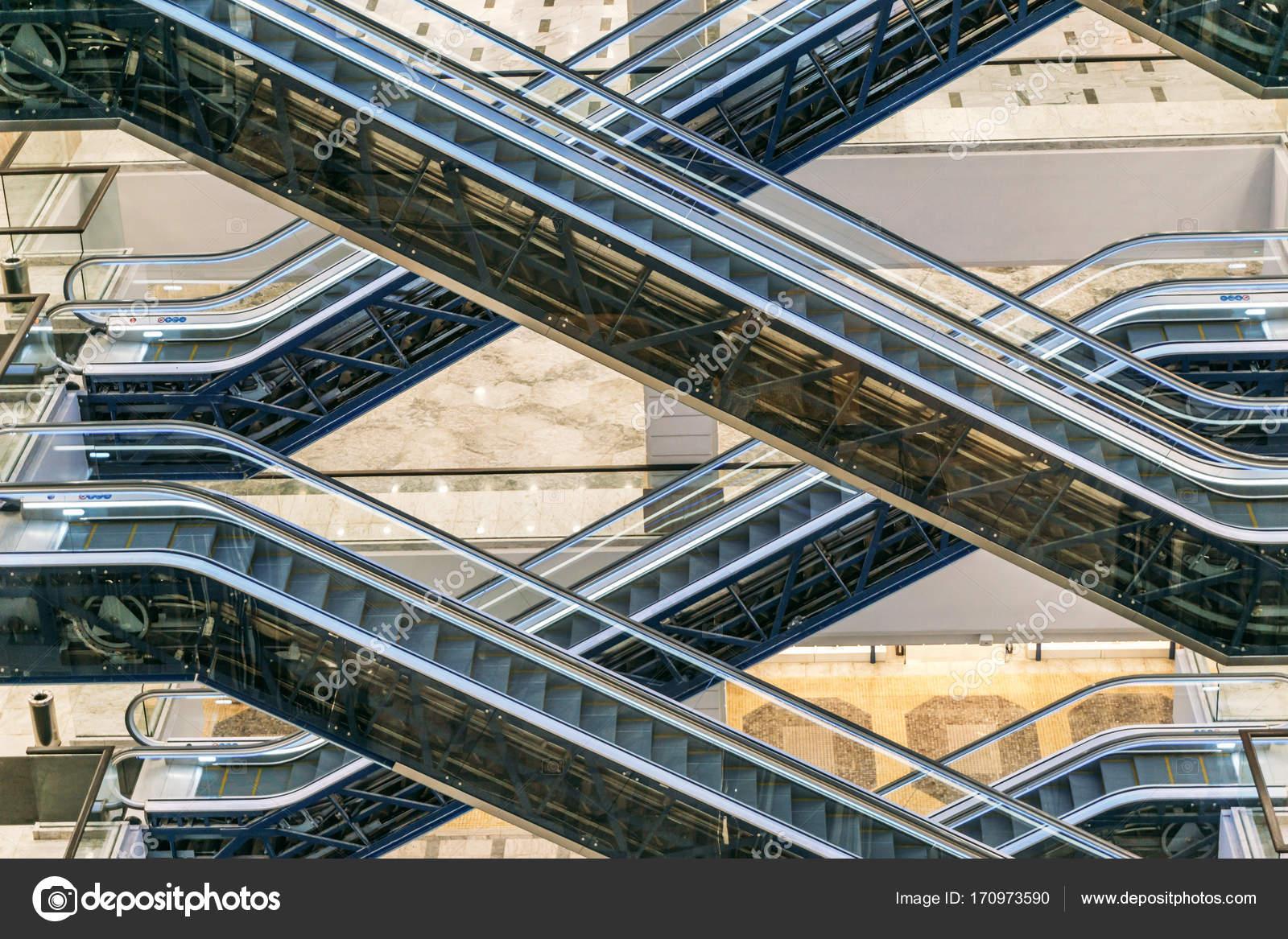 Escalators At Modern Shopping Mall Stock Photo