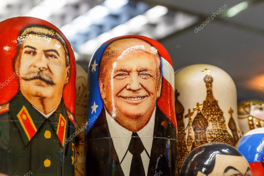 Saint Petersburg, RUSSIA - June 1, 2017: Matryoshka - Russian traditional toy with portraits of  Donald Trump and Joseph Stalin, Russian souvenirs in St. Petersburg