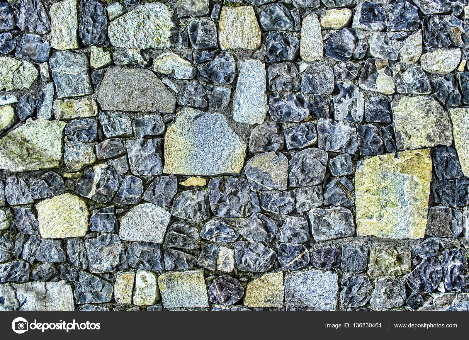 Fragment of old brick wall with river stones texture white grey ...