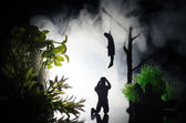 Photo Horror view of hanged girl on tree at evening (at night) Suicide decoration. Death punishment executions or suicide abstract idea.