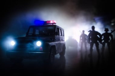 Anti-riot police give signal to be ready. Government power concept. Police in action. Smoke on a dark background with lights. Blue red flashing sirens. Dictatorship power.