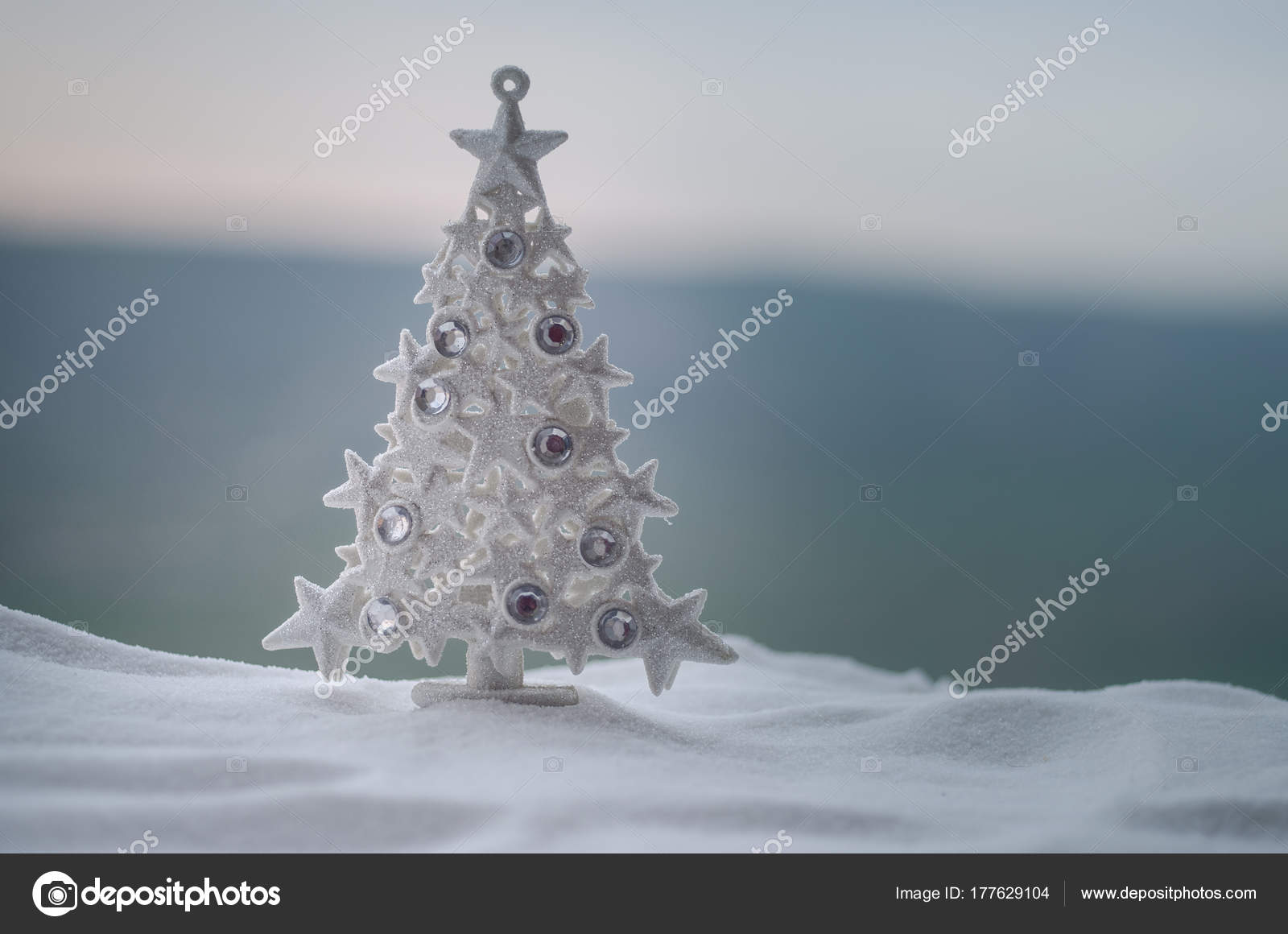 cccfc8049ca Christmas background with snowy fir trees. Snow Covered Christmas Tree  stands out brightly against blurred nature background. Outdoor– stock image