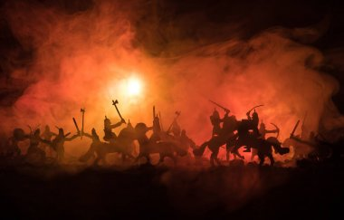 Medieval battle scene with cavalry and infantry. Silhouettes of figures as separate objects, fight between warriors on dark toned foggy background. Night scene. Selective focus stock vector