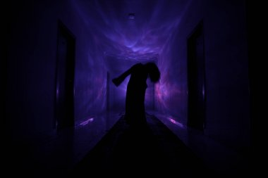 Creepy silhouette in the dark abandoned building. Dark corridor with cabinet doors and lights with silhouette of spooky horror person standing with different poses.