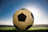soccer ball on soccer field. Football on green grass. Sunny background