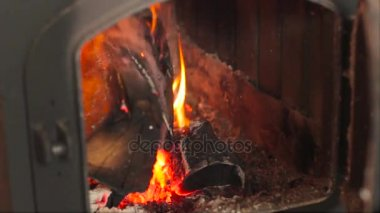in the furnace of burning fire