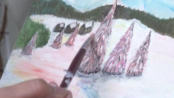 der Künstler malt ein Bild mit Öl