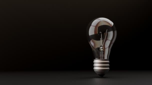 3D žárovka svítí na černém pozadí