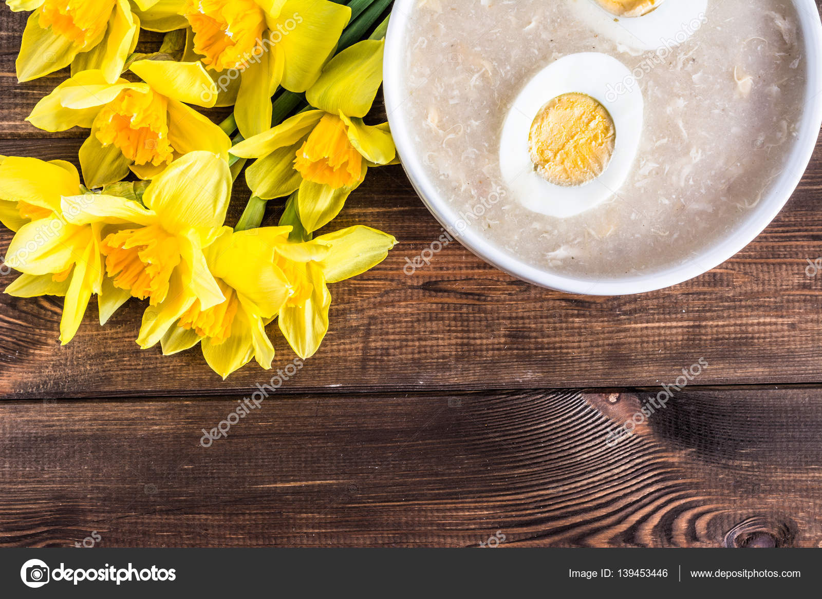 Traditional easter soup white borscht with eggs and daffodils traditional easter soup white borscht with eggs and daffodils easter greeting card stock photo m4hsunfo Images