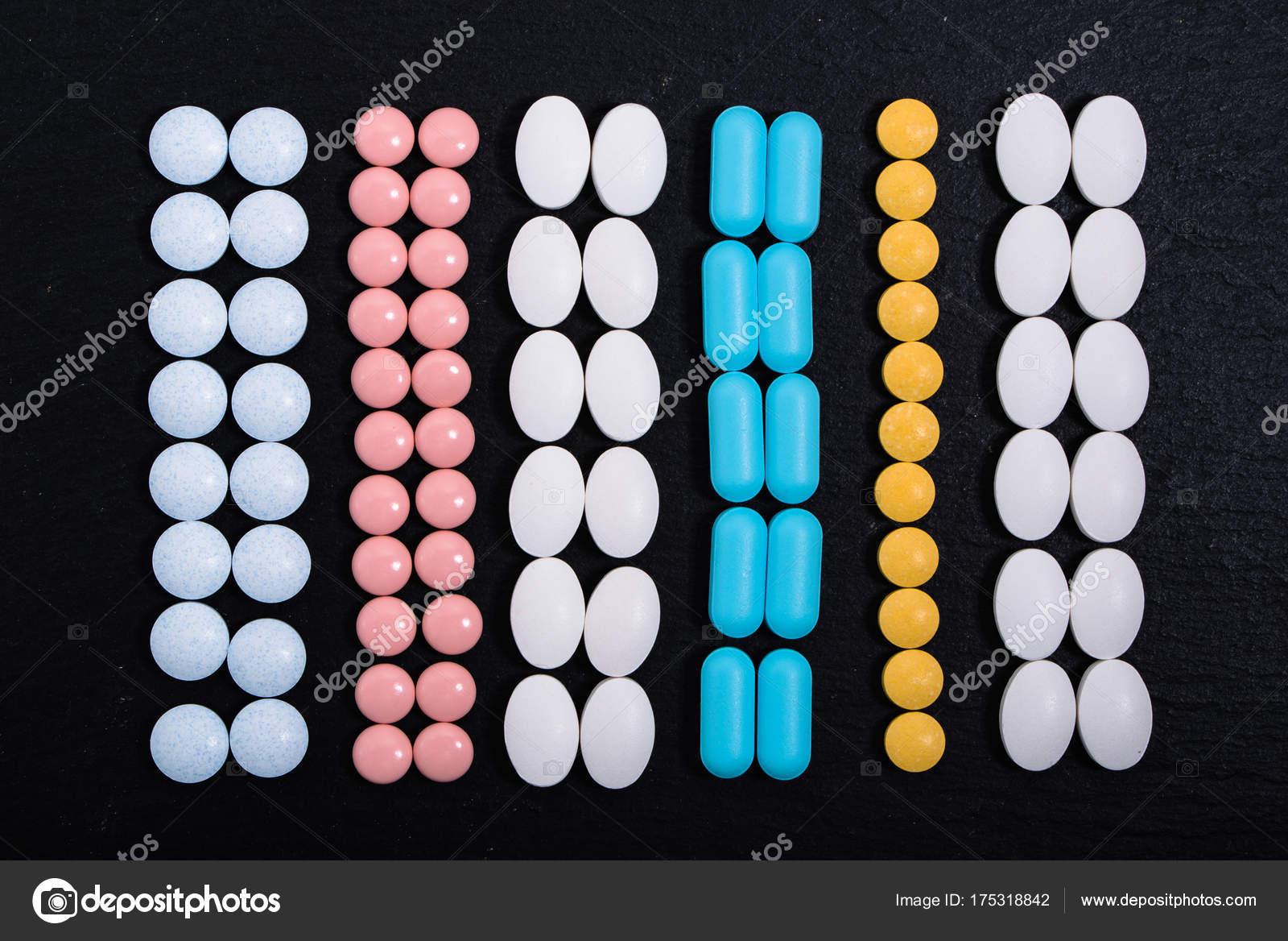 Different medicines  Pills, tablets on black background