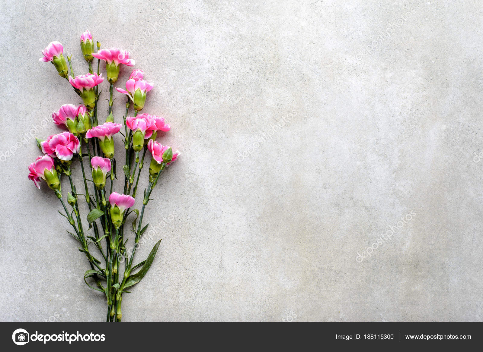 Fresh pink flowers bouquet on gray background, flat lay, top view ...