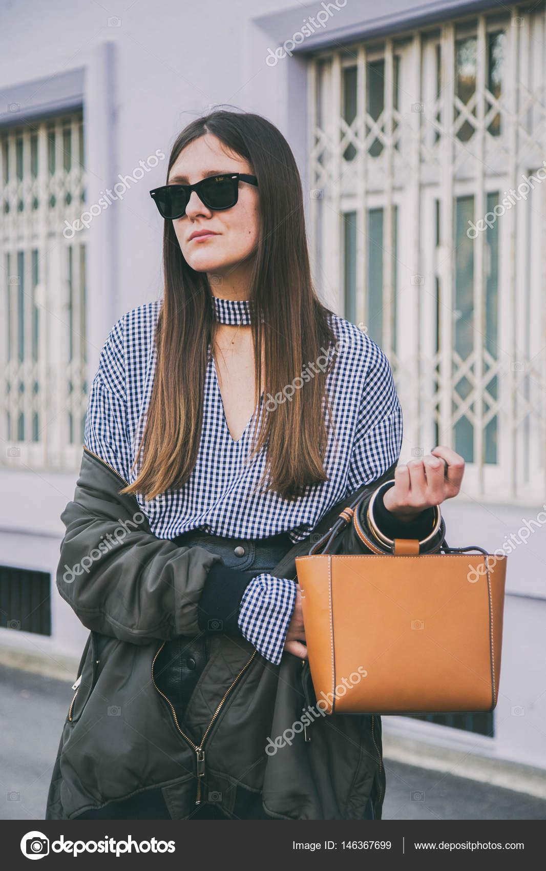 c15caeba95e fashionable young woman wearing sunglasses