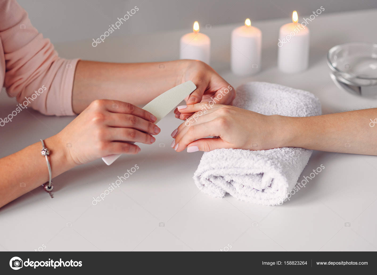 Close up of beautiful female hands having spa manicure at beauty ...
