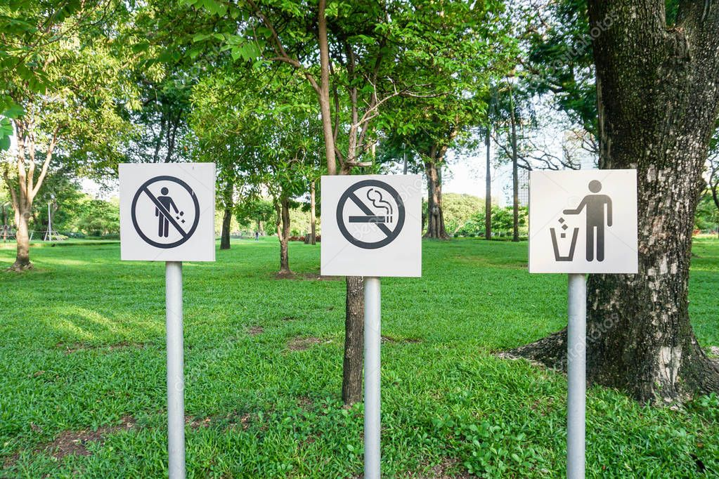 no litter and no smoking sign board in the park
