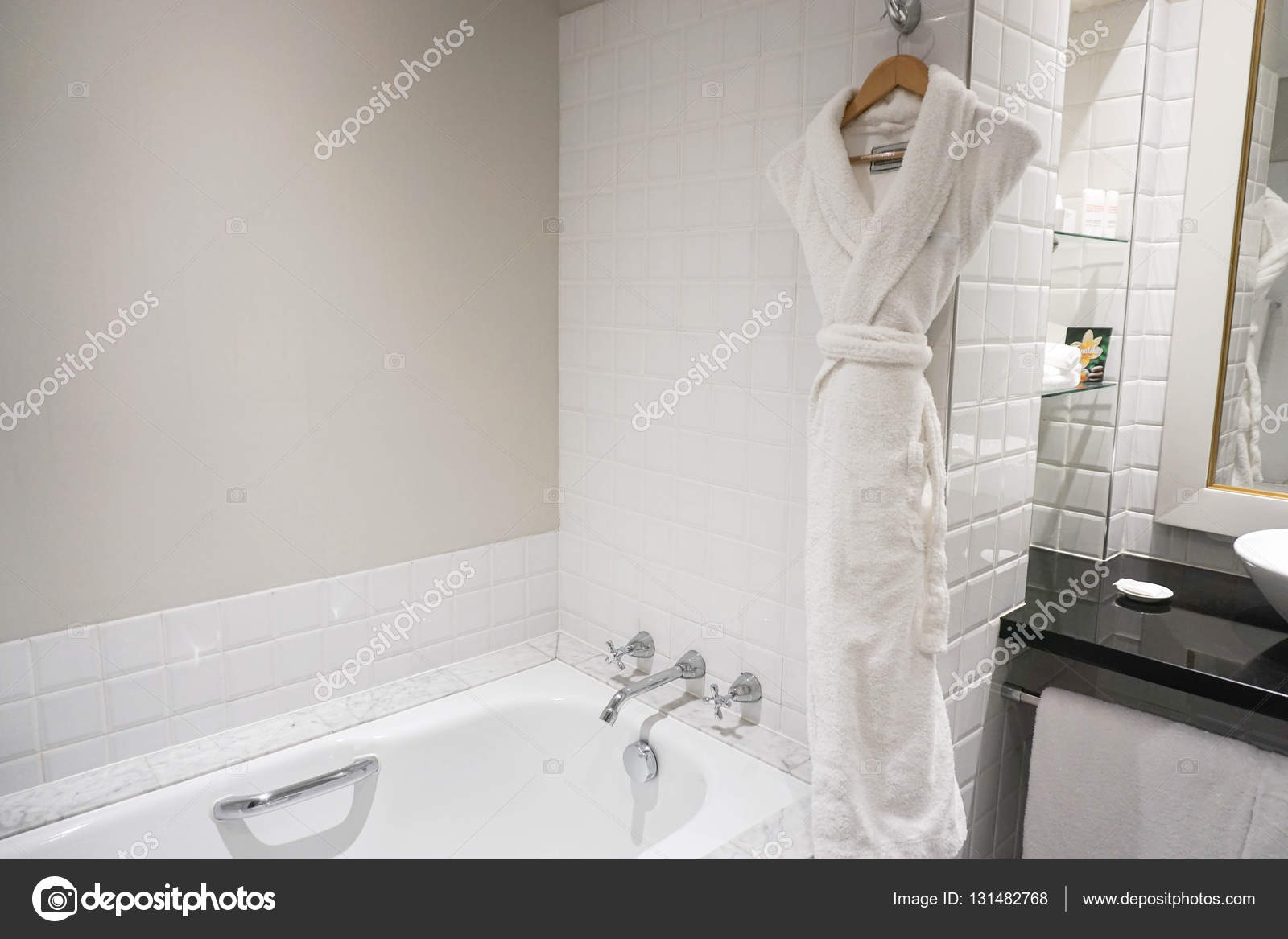 Inside the bathroom with bathtab and bathrobe — Stock Photo © Jummie ...