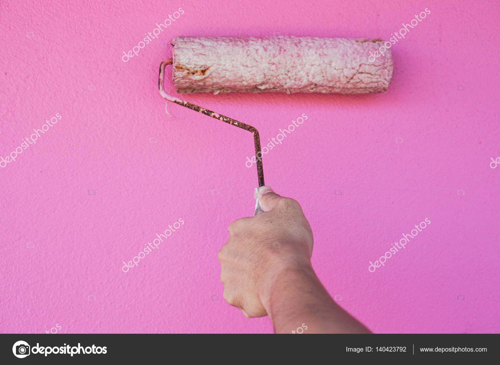 man paint house with pink color — Stock Photo © Jummie #140423792