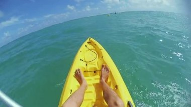 the guy swims on a kayak in the ocean
