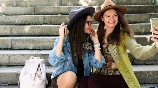 young woman friends having fun, making face and taking selfies
