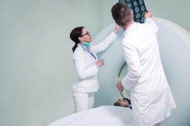 Nurse preparing patient for CT scan test in hospital room