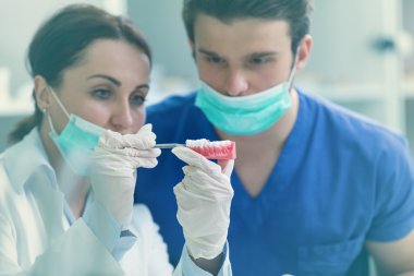 Dental students while working on the denture