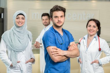 male and female doctors gesturing at hospital