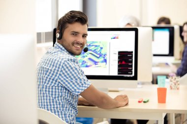 Man Working At computer Desk