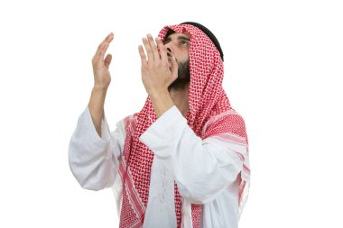 Young arab man praying