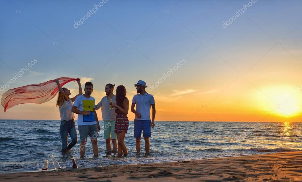 happy young people at the beach