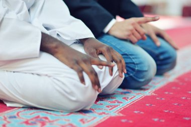 Two religious muslim man praying