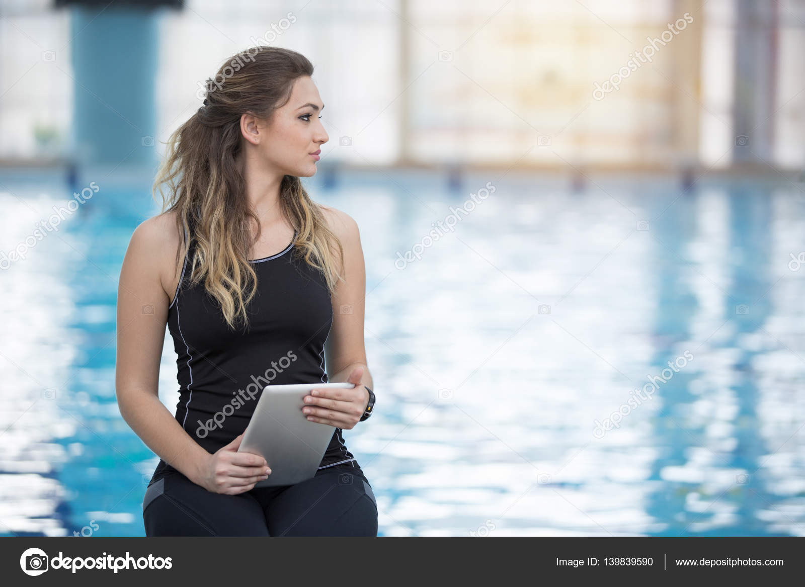 Fit female swimming trainer at the pool