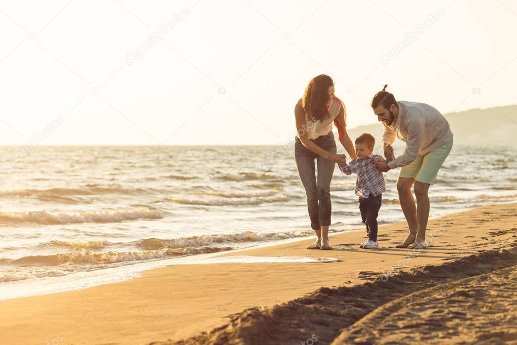 young family have fun on beach