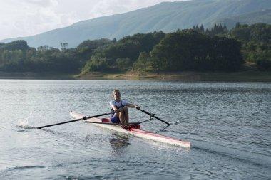 Child rowing on single kayak