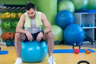 Handsome Male athlete at gym