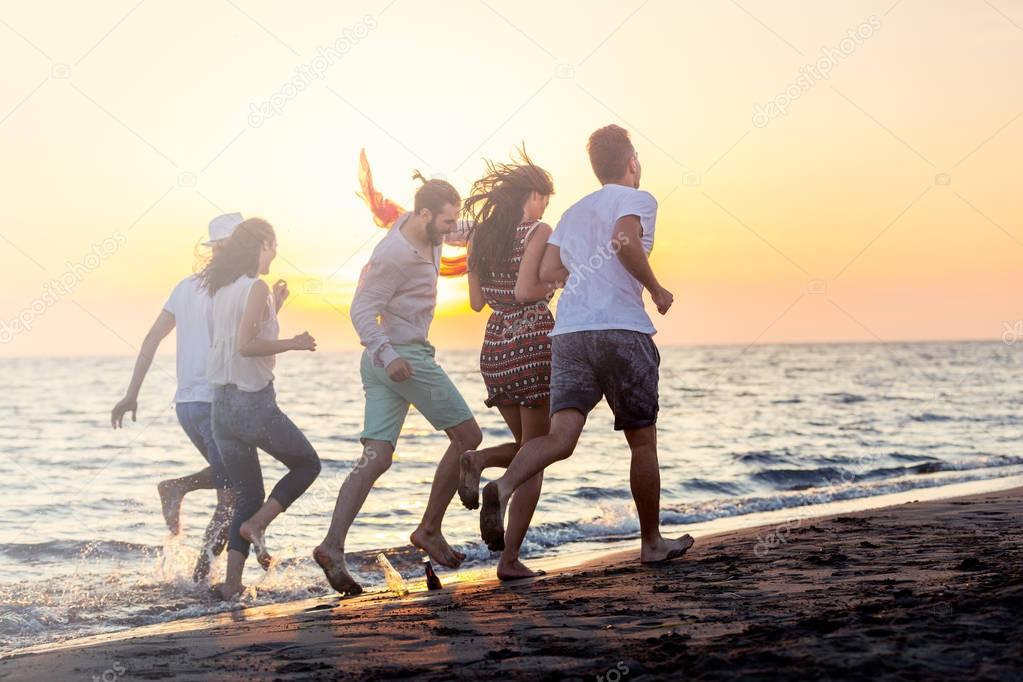 young people running on beach