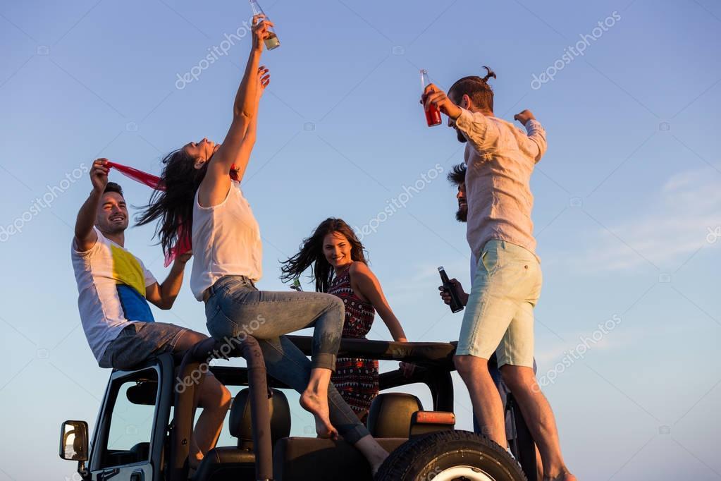 young people having fun on the beach