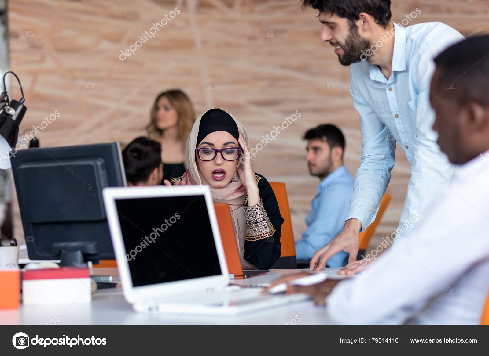 Diverse College Students Using Laptop And Talking Learning Exchanging Ideas Stock Photo