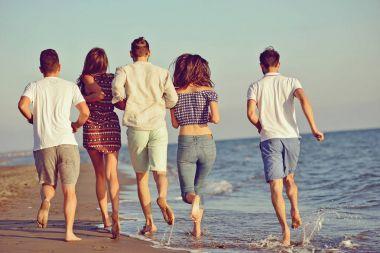 Friends fun on the beach under sunset sunlight stock vector