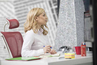Business and entrepreneurship consept. Beautiful blonde business woman working on laptop