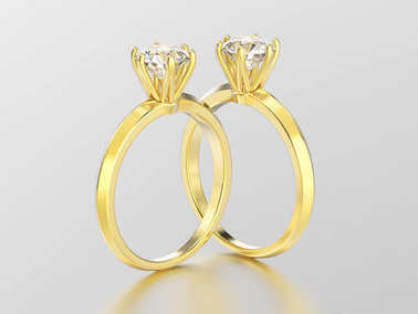 3D illustration two yellow gold traditional solitaire engagement