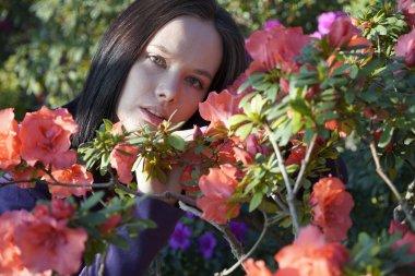 """Картина, постер, плакат, фотообои """"woman posing with azalea flowers in garden"""", артикул 346884604"""