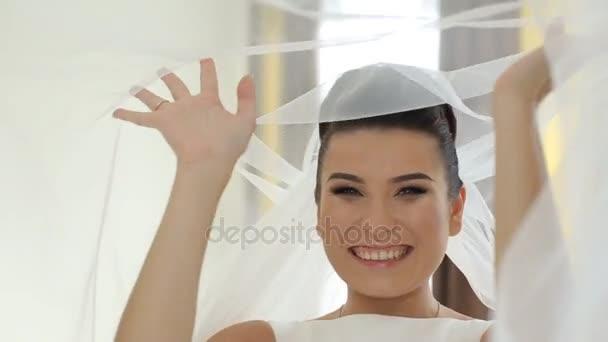 Happy bride smile near her dress