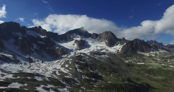Aerial breathtaking view of mountain glaciers on the top of the Swiss Alps