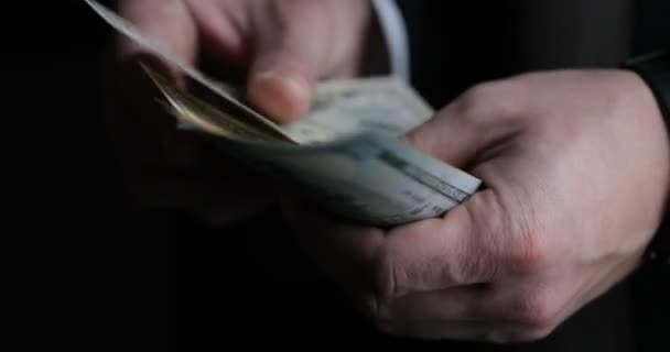 Close-up of male accountant or banker counting American bills. Savings, finances and economy concept
