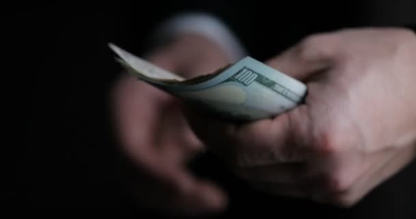 Close-up of male businessman or banker counting American bills. Savings, finances and economy concept