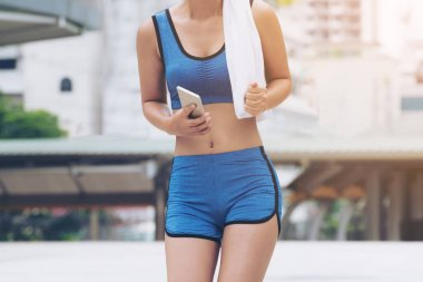 Sport woman runner using smartphone