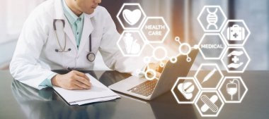 Medical concept - Doctor on Computer with Icons