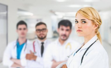 Doctor working in hospital to fight 2019 coronavirus disease or COVID-19. Professional healthcare people with other doctors, nurse and surgeon. Corona virus medical care and protection concept.