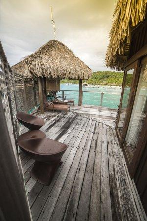 Luxury thatched roof honeymoon bungalow in Bora Bora