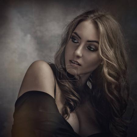 Vamp style blonde female portrait with faded colours